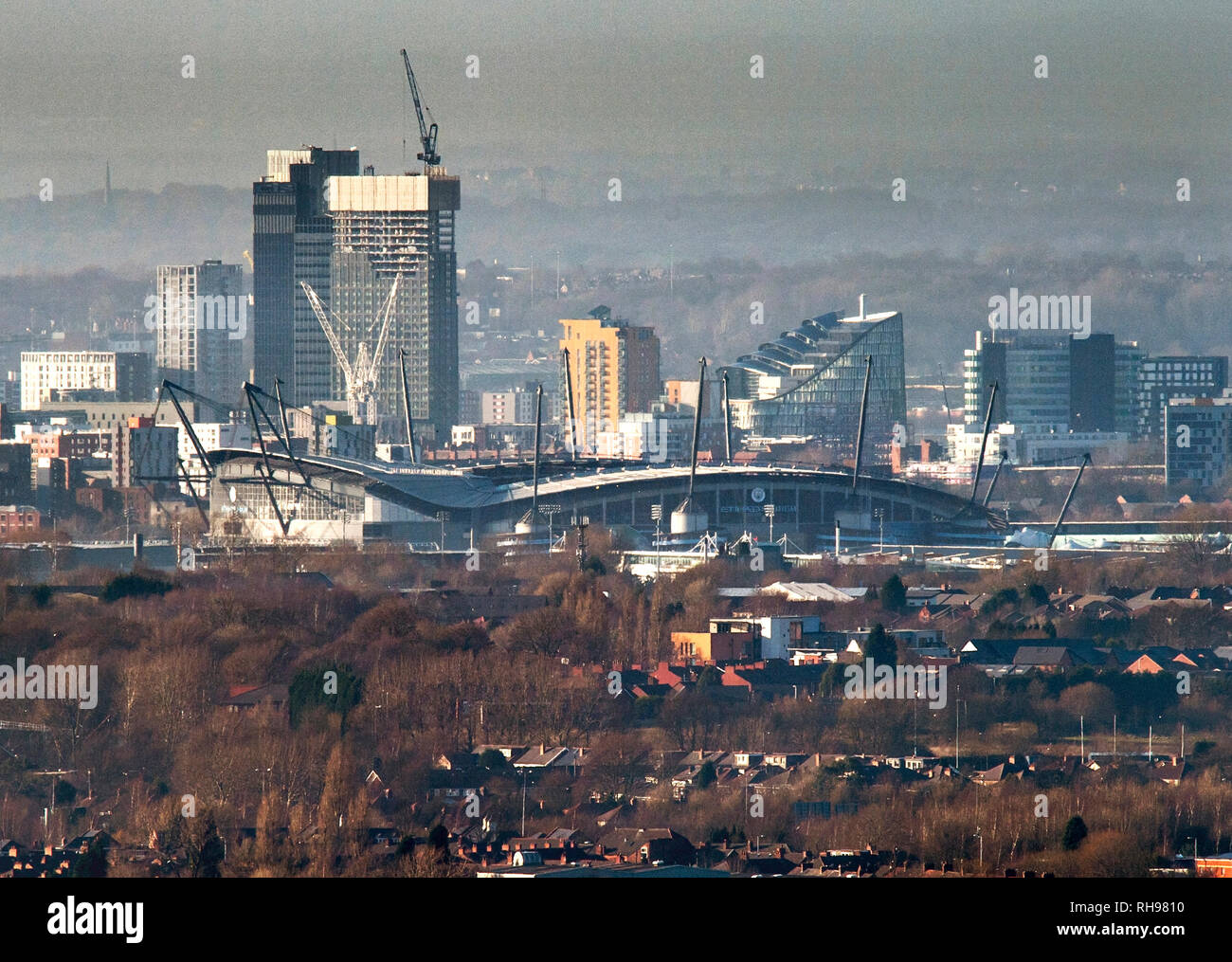 The Etihad Stadium, home of Manchester City FC is seen surrounded by construction work - Stock Image