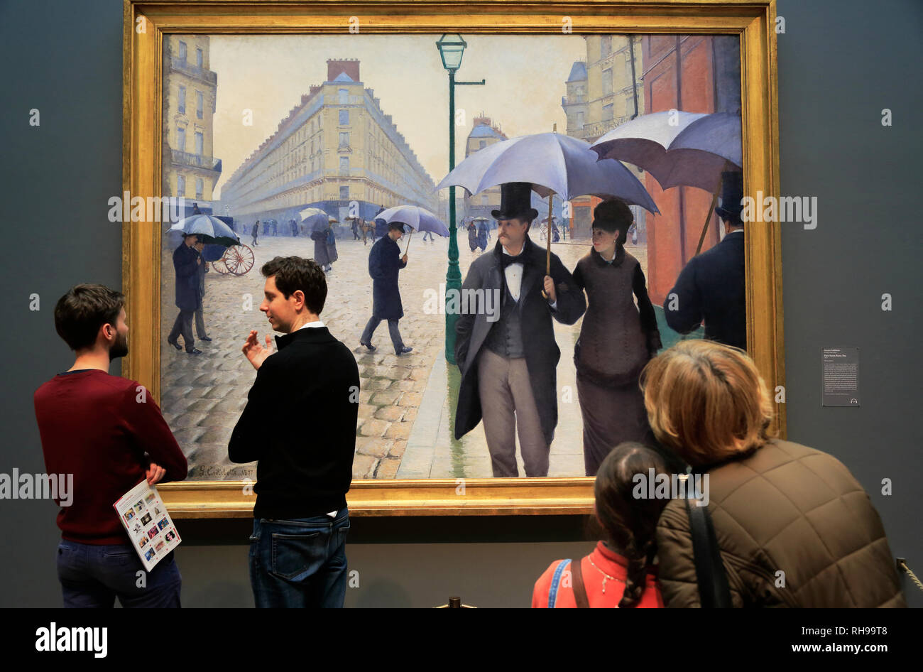 Visitors enjoying the 'Paris Street; Rainy Day' (Rue de Paris, temps de pluie) by Gustave Caillebotte in Art Institute of Chicago.Chicago.Illinois.USA - Stock Image