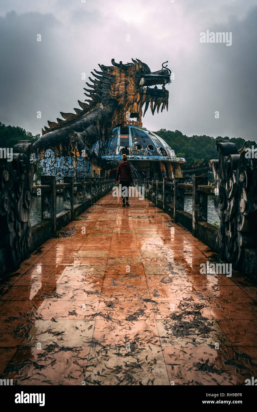 Dark tourism attraction Ho Thuy Tien abandoned waterpark, close to Hue city, Central Vietnam, Southeast Asia. Famous Dragon statue in the middle of th Stock Photo