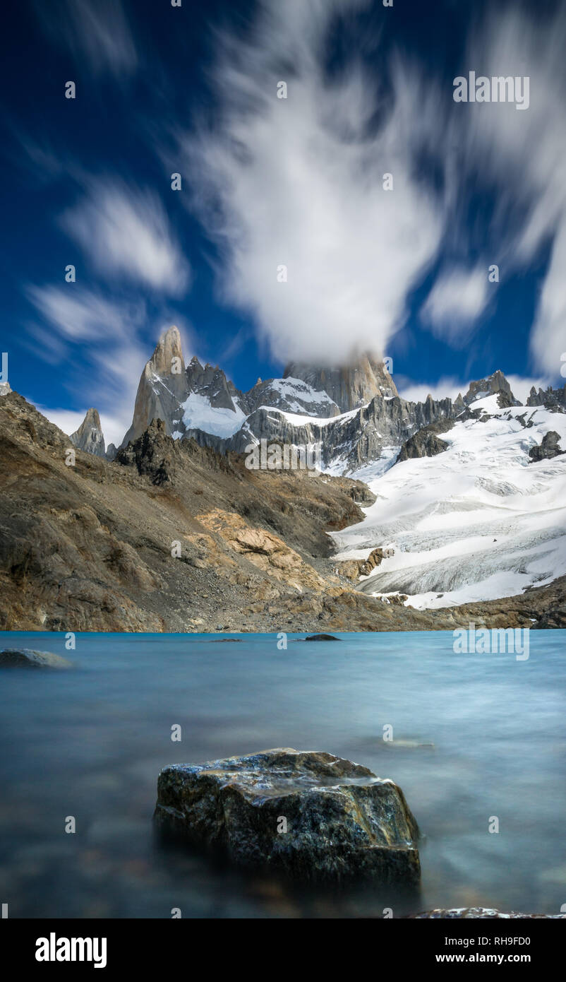 a long exposure picture with movement of clouds at Laguna de Los Tres with iconic Mount Fitz Roy - Stock Image