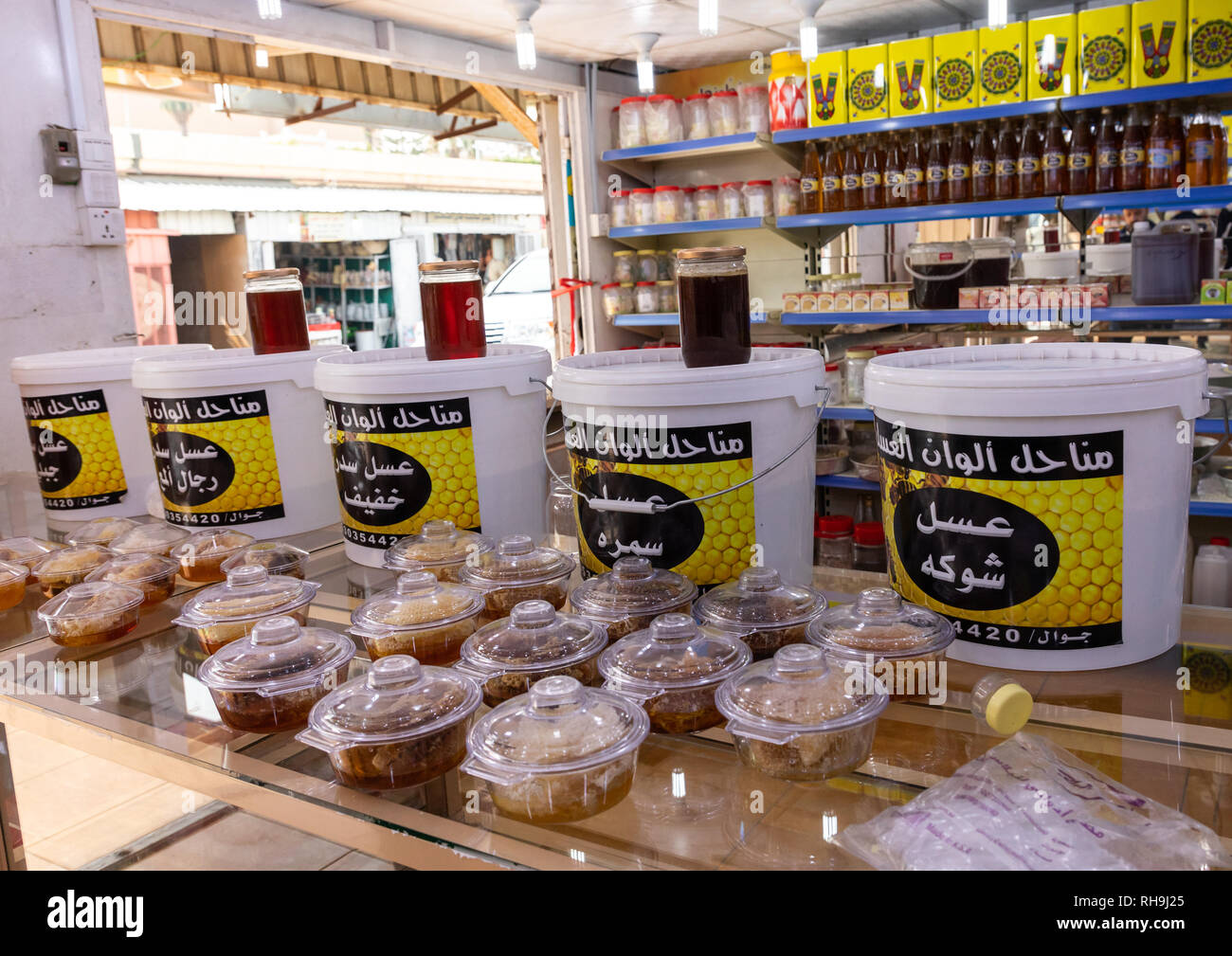 Honey and honeycombs for sale in a shop, Asir province, Abha, Saudi