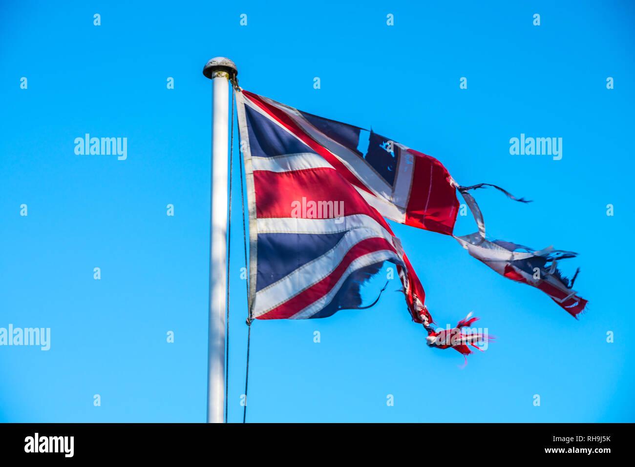 Badly torn Union Jack Flag symbol of the disharmony within UK over Brexit - Stock Image