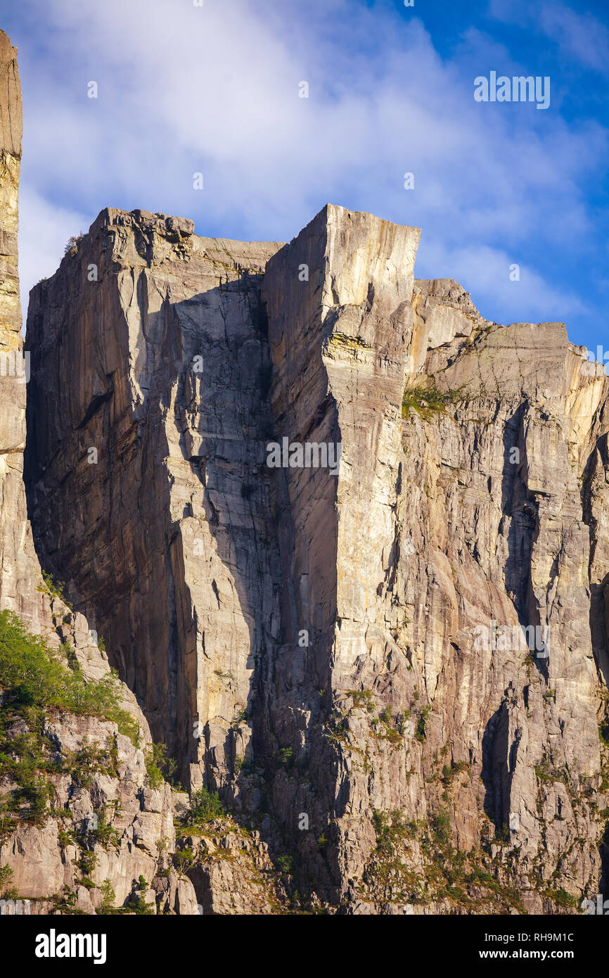 Preikestolen or Prekestolen (Preachers Pulpit, Preachers Chair or Pulpit Rock) steep cliff as seen from Lysefjord (Lysefjorden) fjord, a major tourist Stock Photo