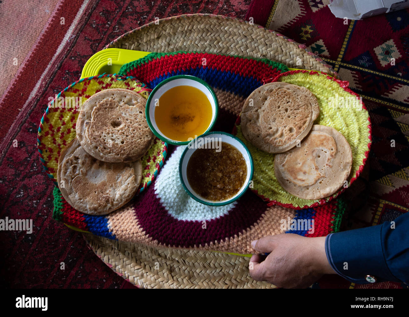 Bread with ghee and honey served to guests in a majlis, Asir