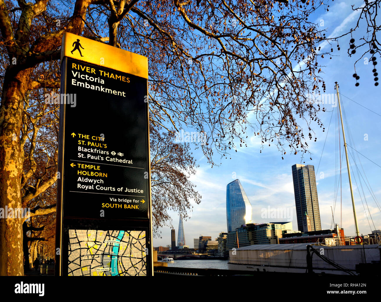 London, England, UK. River Thames, tourist information map and buildings on the South Bank seen from the Victoria Embankment. - Stock Image