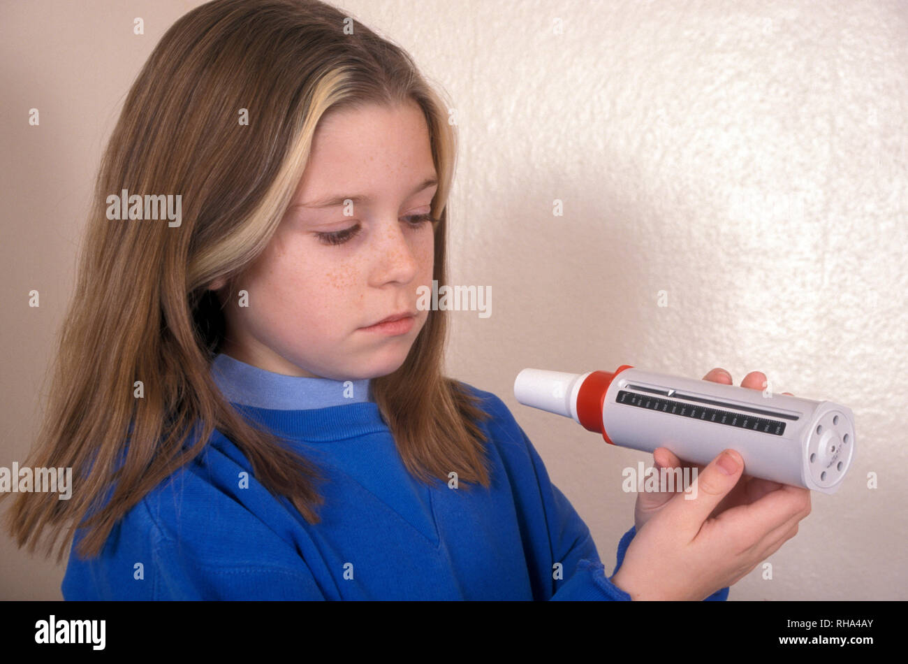 young girl taking spirometry test for asthma - Stock Image