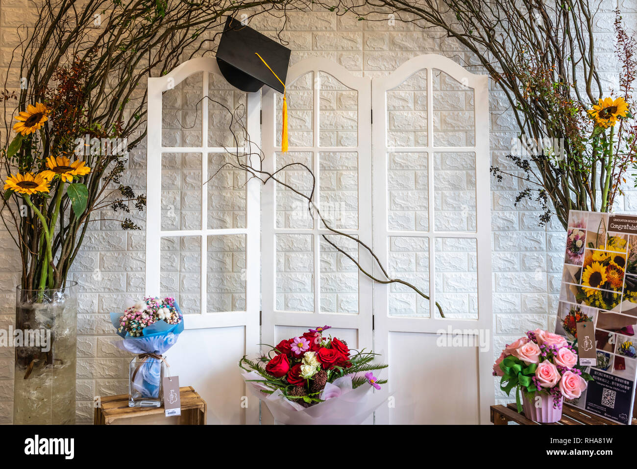 A graduation display in a flower shop in the Flower Market of Kowloon, Hong Kong, China, Asia. - Stock Image
