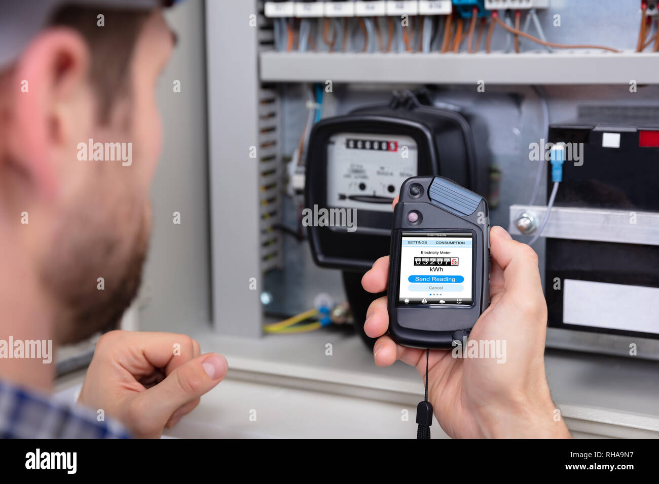 Close-up Of A Male Technician Doing Meter Reading - Stock Image