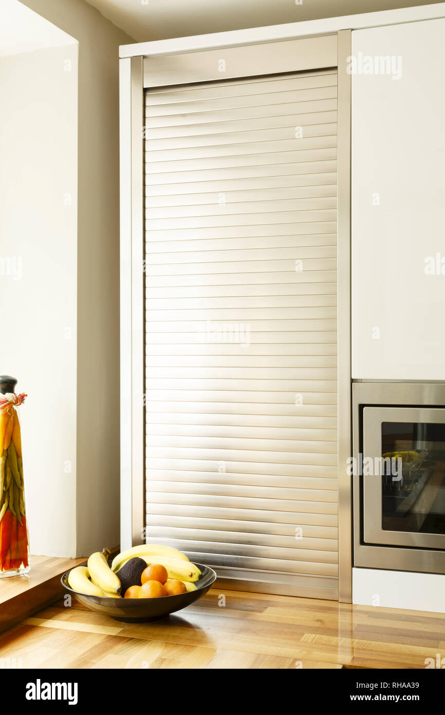Modular Kitchen With A Tambour Unit Or Roller Shutter