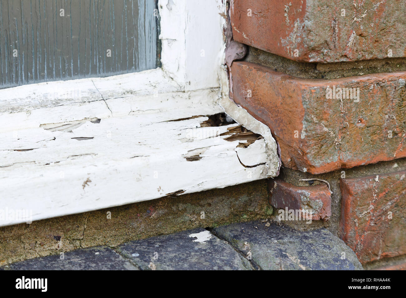 Closeup of a rotten old wooden window frame - Stock Image