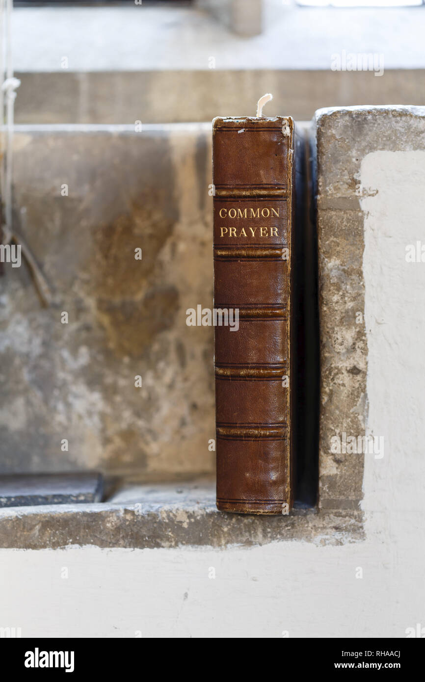 Ancient prayer book in an old church. Depicts praying and christianity - Stock Image