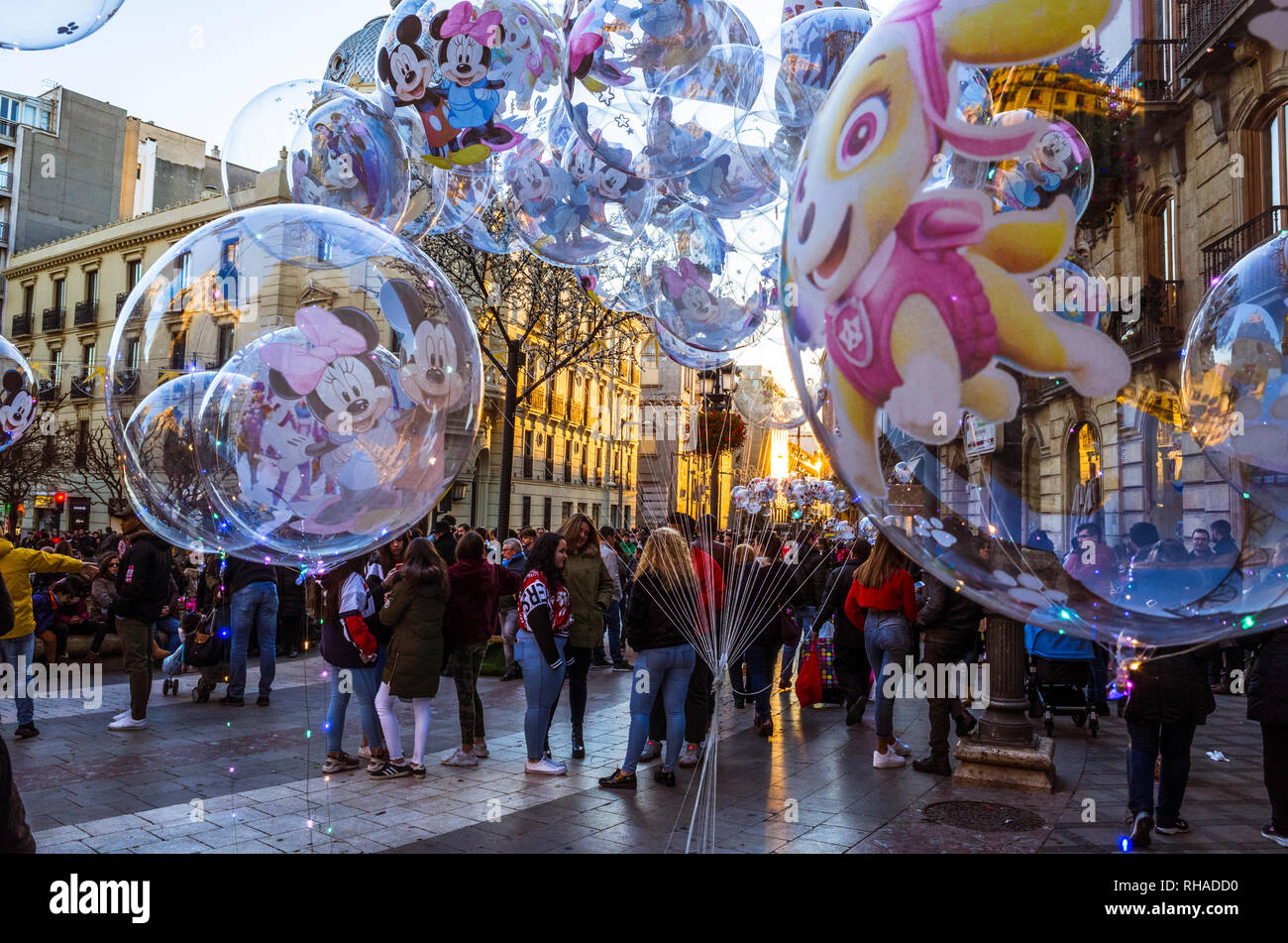 Granada, Andalusia, Spain - January 5th, 2019 : People gather in Puerta Real square waiting for the Cabalgata de Reyes Magos (Kings' Day parade) - Stock Image