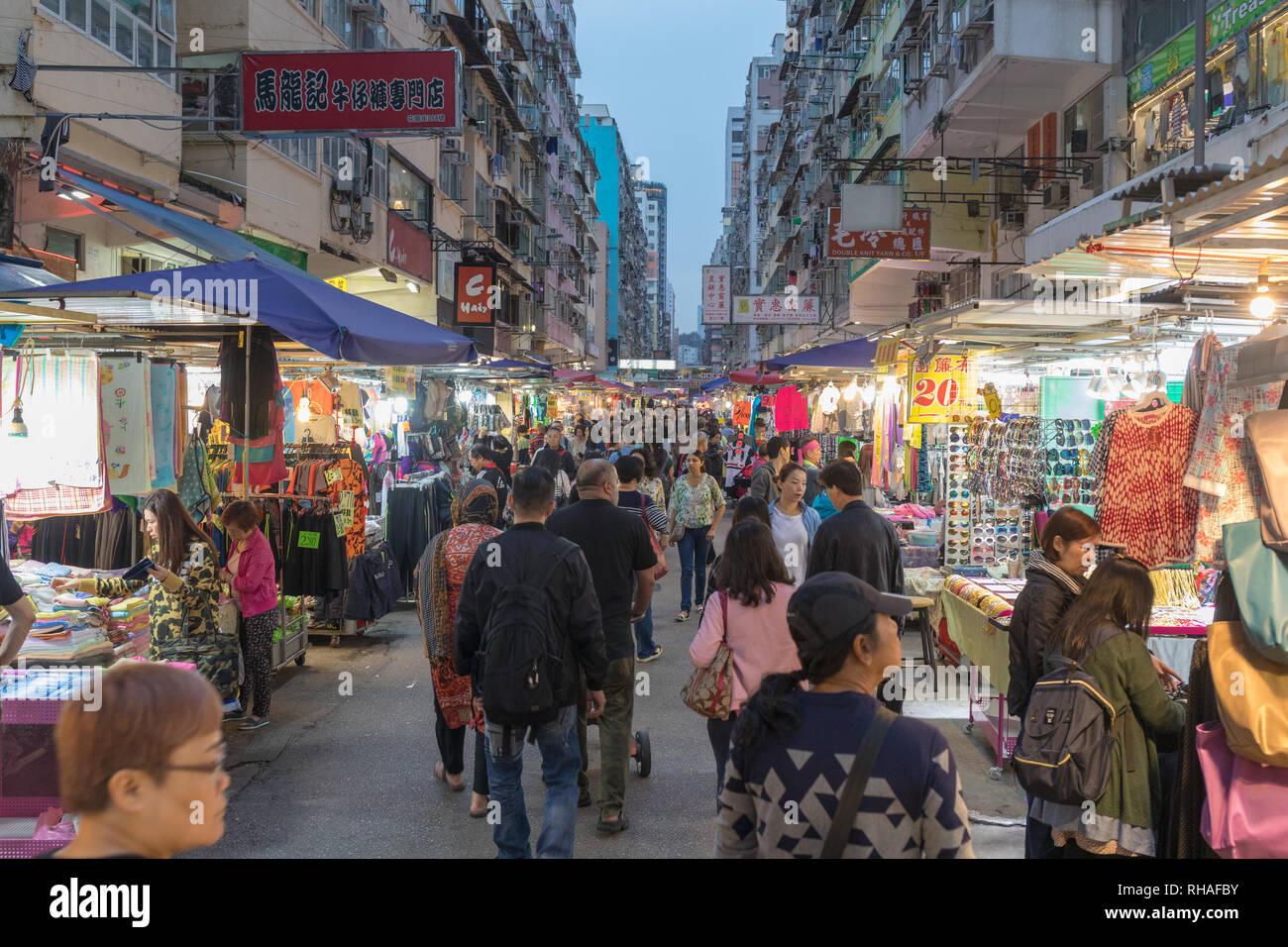 Kowloon, Hong Kong - April 22, 2017: People Shopping at Fa Yuen Street Market in Mong Kok, Kowloon, Hong Kong. - Stock Image