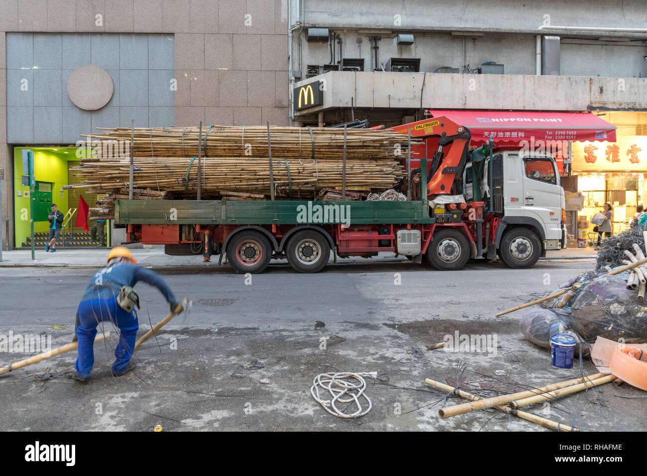 Kowloon, Hong Kong - April 22, 2017: Bamboo Scaffoldings at Truck in Mong Kok, Hong Kong, China. - Stock Image