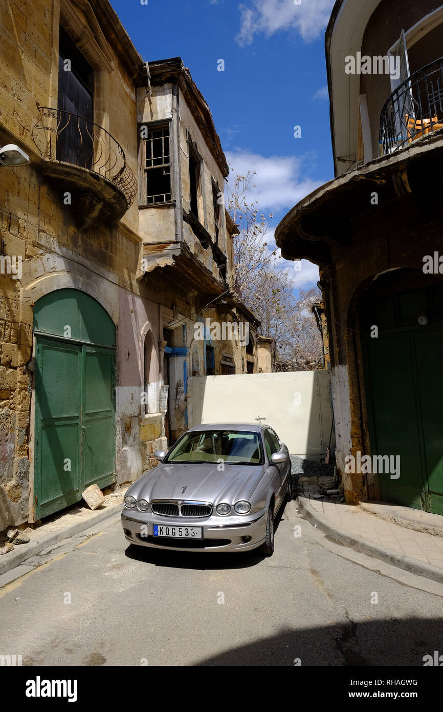 Car parked in a street divided by a barricade along the Green Line in the divided capital of Nicosia, Cyprus - Stock Image