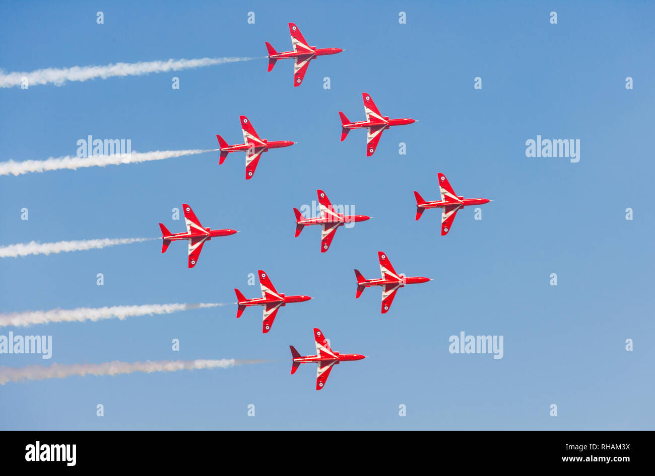 DUBAI, UAE - NOVEMBER 11, 2007: The Royal Air Force's Red Arrows aerobatic team flying over Dubai in BAE Hawk aircraft. Stock Photo