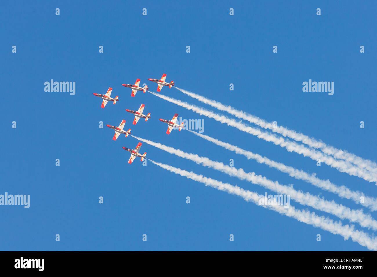 DUBAI, UAE - NOVEMBER 11, 2007: The Spanish Air Force Aerobatic Team, Patrulla Aguila (Eagle Patrol), flying over Dubai. Stock Photo