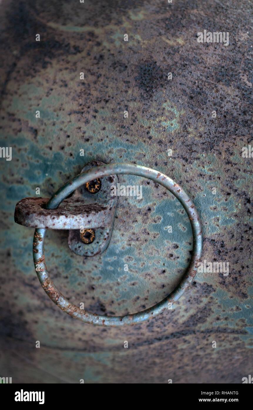 metal ring on metal plate - Stock Image