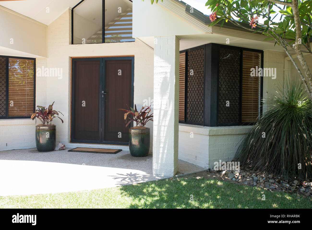 Real estate images of the exterior of a house for sale - Stock Image