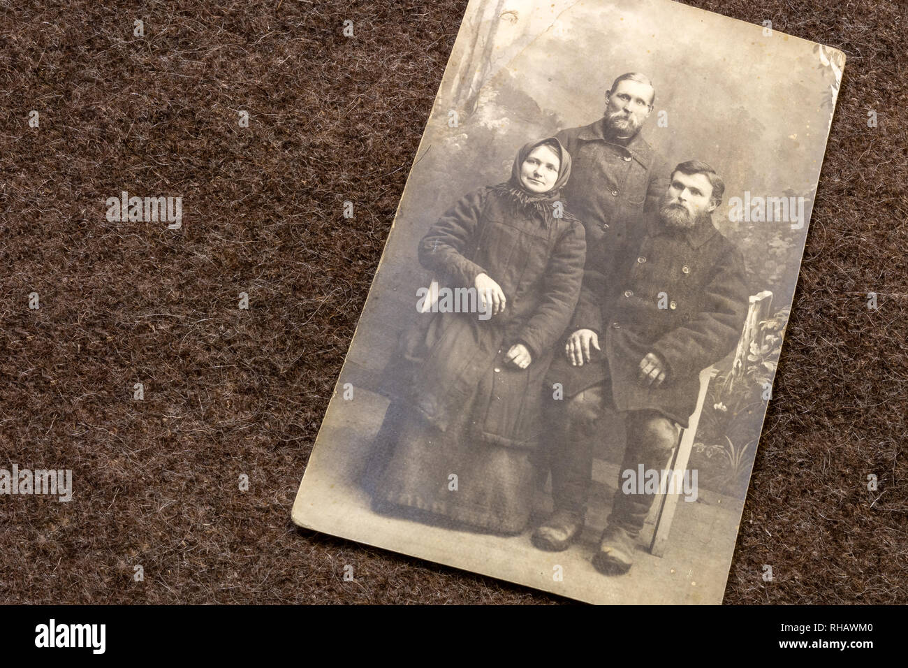 Portrait of farmers family in period of World War I on trench coat background - Stock Image