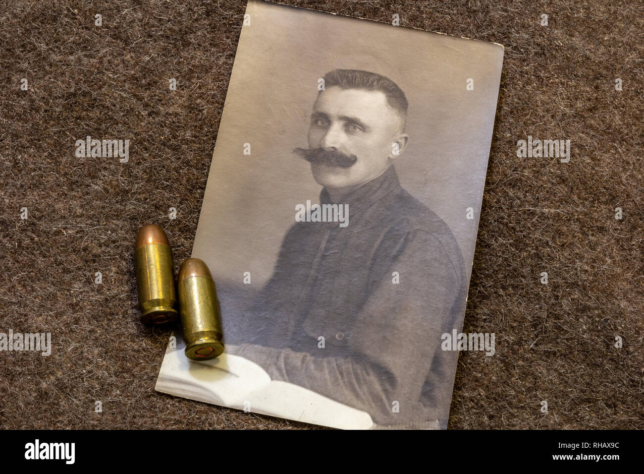 Portrait of officer in period of World War I and pistol bullets on trench coat - Stock Image