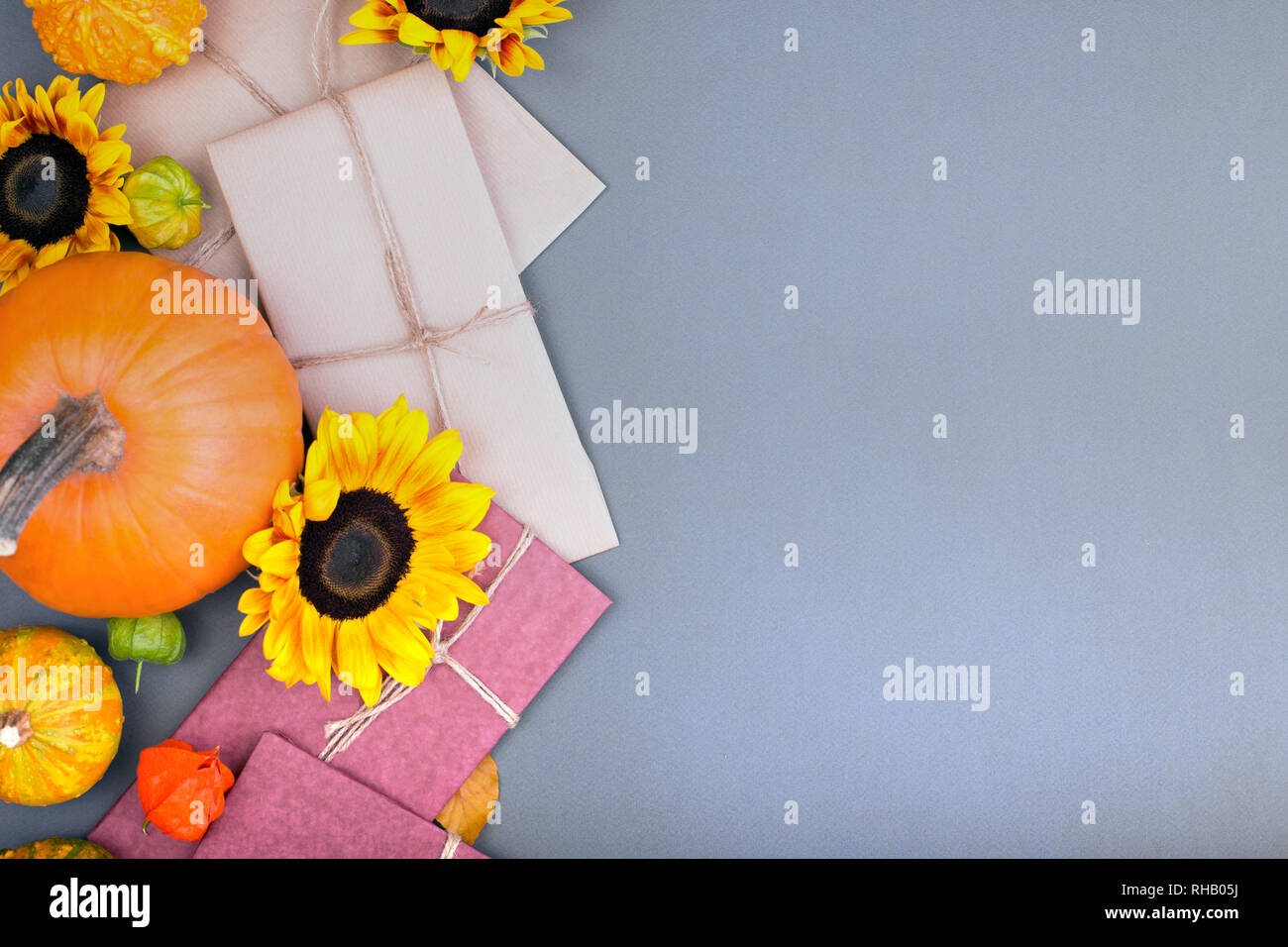 Top View Of Handcraft Gift Box And Pumpkins On Gray Background