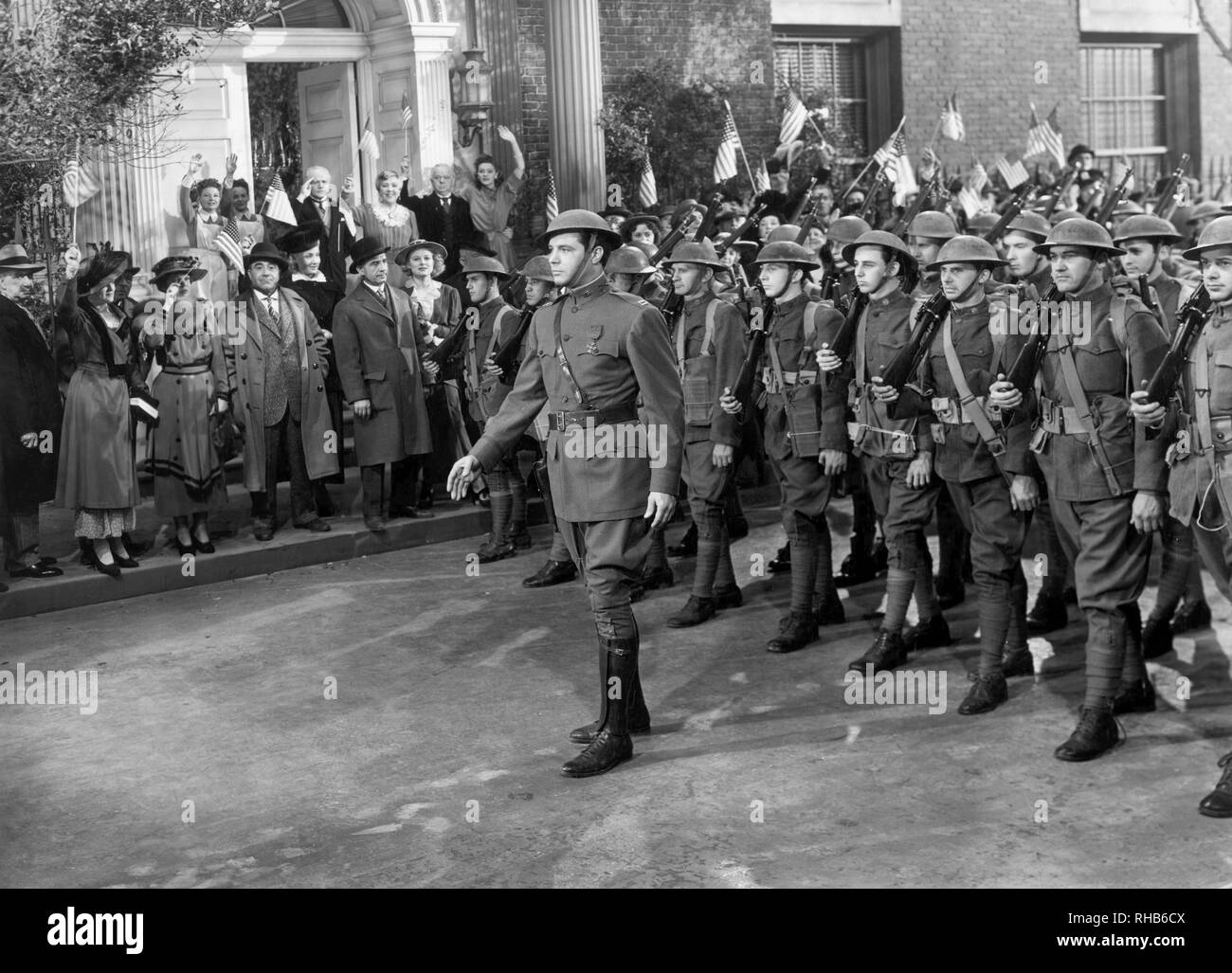 James Craig (center leading March), on-set of the Film, 'Friendly Enemies', United Artists, 1942 - Stock Image