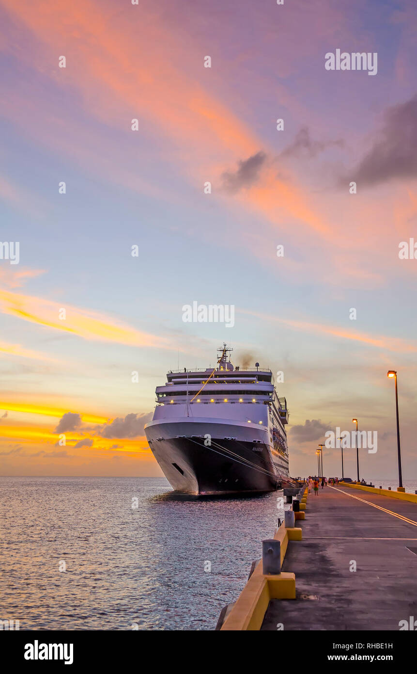 Cruise ship docked Frederiksted pier at twilight colortful clouds ms Maasdam Saint Croix, United  States Virgin Islands  USVI Stock Photo