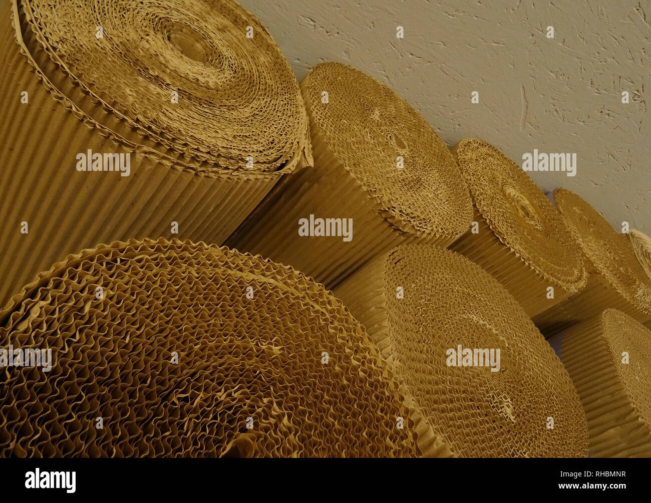 Cardboard rolls at the paper production factory storage stock image - Stock Image