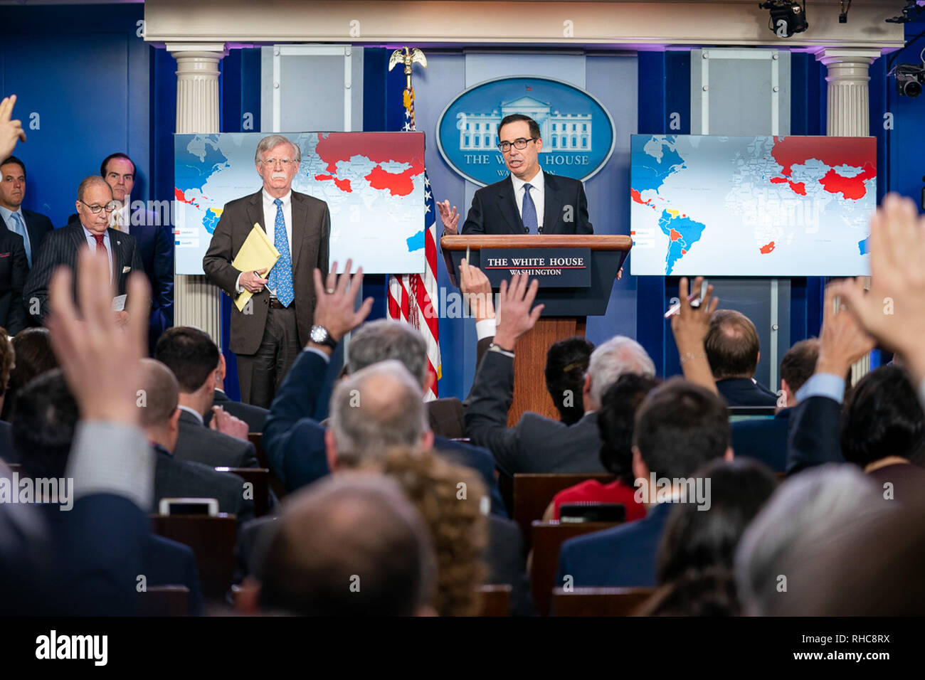 Secretary of the Treasury Steven Mnuchin, joined by National Security Advisor John Bolton and Director of the National Economic Council Larry Kudlow, addresses reporters in the James S. Brady Press Briefing Room at the White House Monday, Jan. 28, 2019, to announce additional steps to address the national emergency with respect to Venezuela.   People:  Secretary of the Treasury Steven Mnuchin, - Stock Image