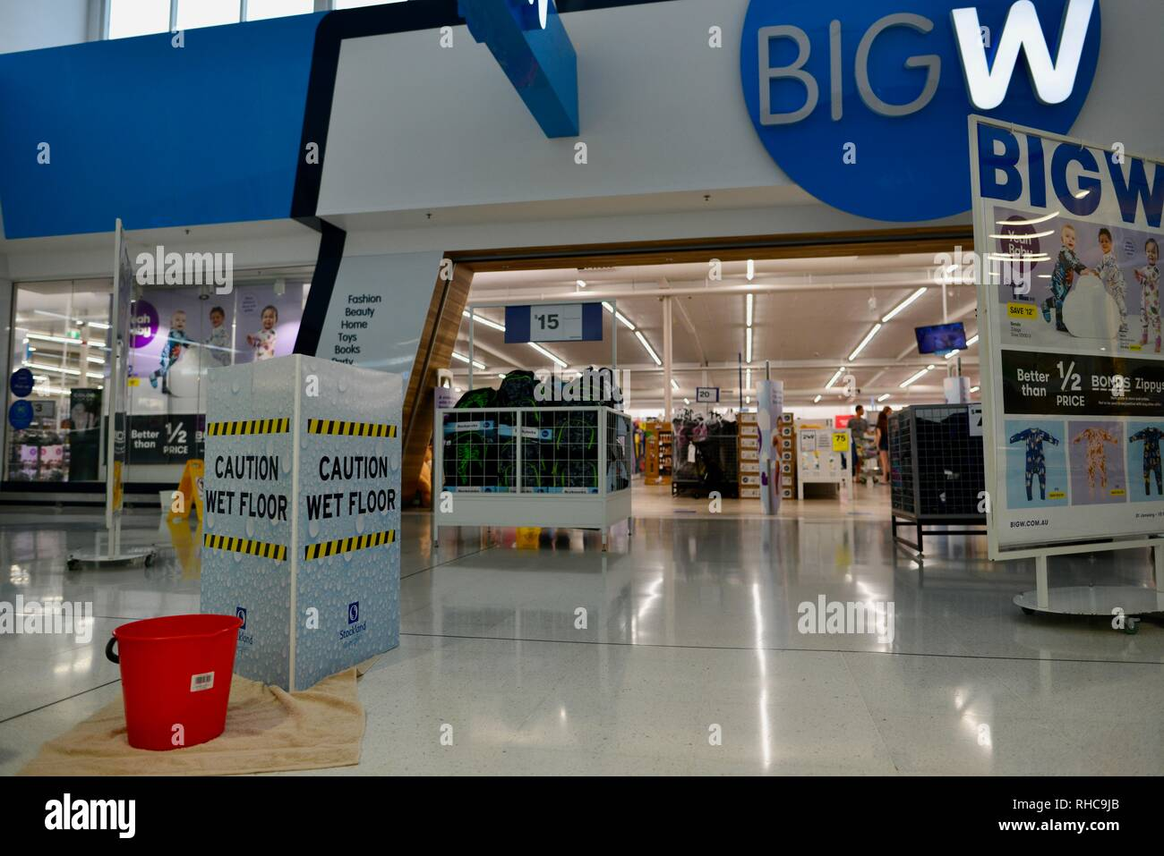 Wet floors due to roof damage outside big W, Inside