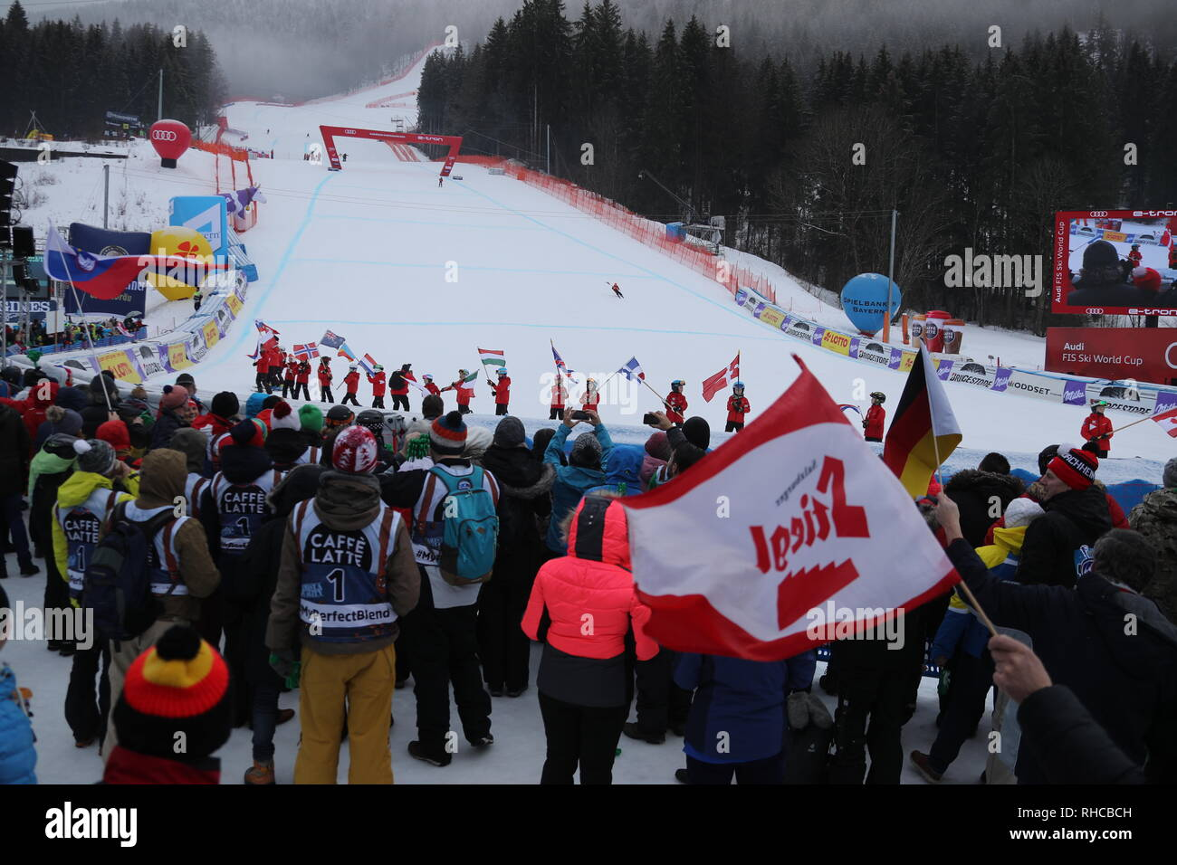 Garmisch Partenkirchen, Germany. 02nd Feb, 2019. Alpine skiing, World Cup, Downhill, Men: spectators and the flag children after the cancellation of the downhill at the finish. Credit: Stephan Jansen/dpa/Alamy Live News - Stock Image