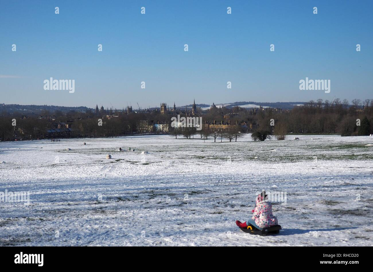 Oxford, UK. 2nd Feb, 2019. A little girl sledging at South Park above the dreaming spires. Credit: Angela Swann/Alamy Live News - Stock Image