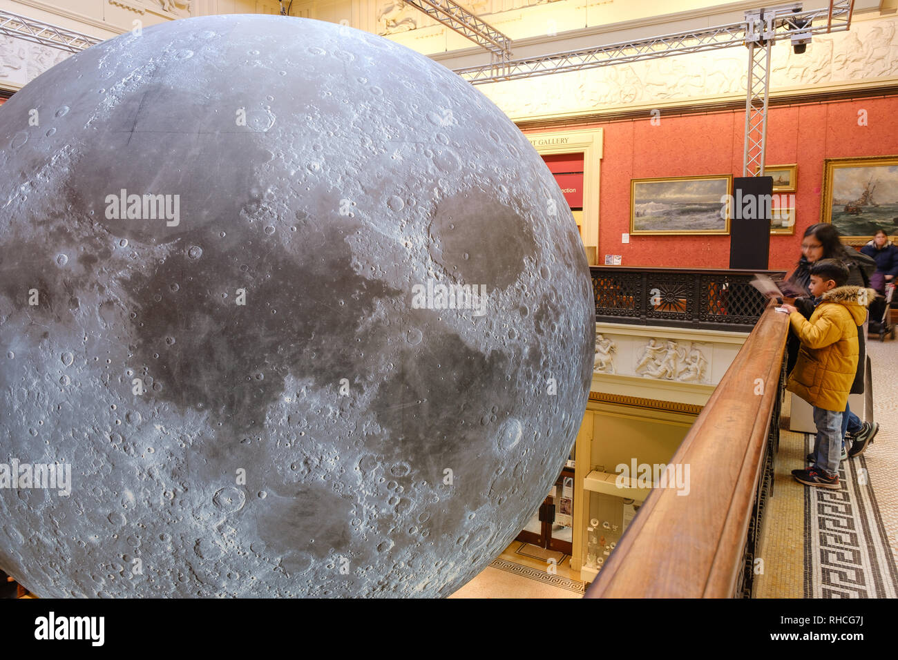 Preston UK, 2nd February 2019. The Harris Museum and Library in Preston opened its doors to the 'Museum of the Moon' exhibition today. British installation artist Luke Jerram's 23-foot high, three dimensional moon model is suspended in the centre of the Grade 1 listed building. Visitors to the exhibition will also hear music composed by BAFTA and Ivor Novello award winning composer Dan Jones. The exhibition runs until Sunday 24th February. Credit: Paul Melling/Alamy Live News - Stock Image
