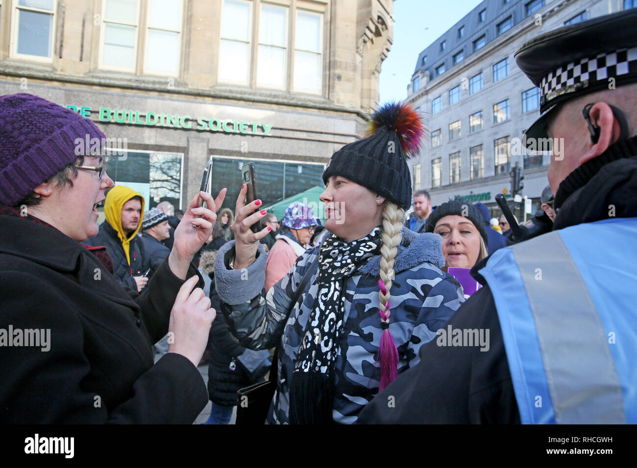 Manchester, UK. 2nd February 2019. Member of right wing 'yellow vest' UK movement on the right,filming an anti racist who is filming her during a stand off in Piccadilly Gardens,  Manchester, UK, 2nd February 2019 (C)Barbara Cook/Alamy Live News Credit: Barbara Cook/Alamy Live News - Stock Image