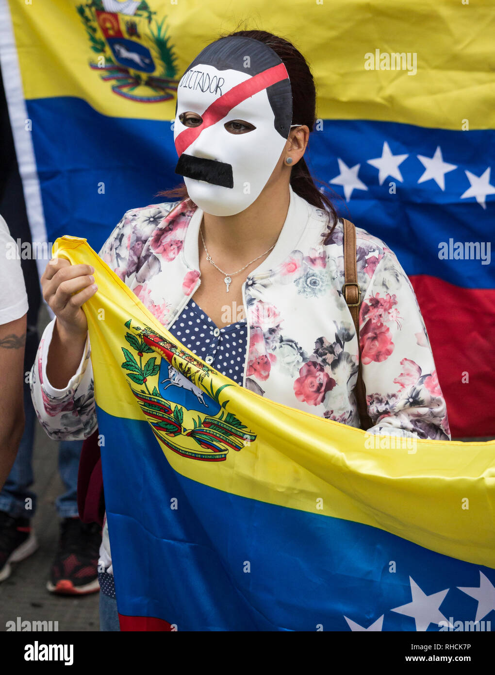 Las Palmas, Gran Canaria, Canary Islands, Spain. 2nd February 2019. Venezuelans living in the Canary Islands join thousands of fellow Venezuelans around the world calling for Nicolas Maduro to step down. PICTURED: A demonstrator wears a Nicolas Maduro mask with Dictator written on it. Credit: ALAN DAWSON/Alamy Live News - Stock Image