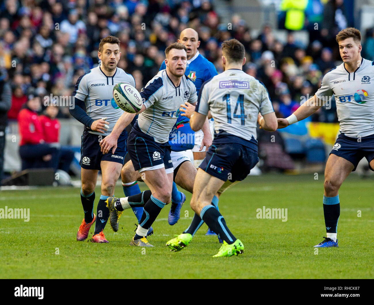 Scotland, UK. 2nd Feb 2019. : Scotland Full-Back, Stuart Hogg offloads the ball to Winger, Tommy Seymour,  during the first half as Scotland play host to Italy in their opening game of the 2019 6 Nations Championship at Murrayfield Stadium, Edinburgh on February 2nd, 2019.  (Photo by Ian Jacobs) Credit: Ian Jacobs/Alamy Live News Credit: Ian Jacobs/Alamy Live News Stock Photo