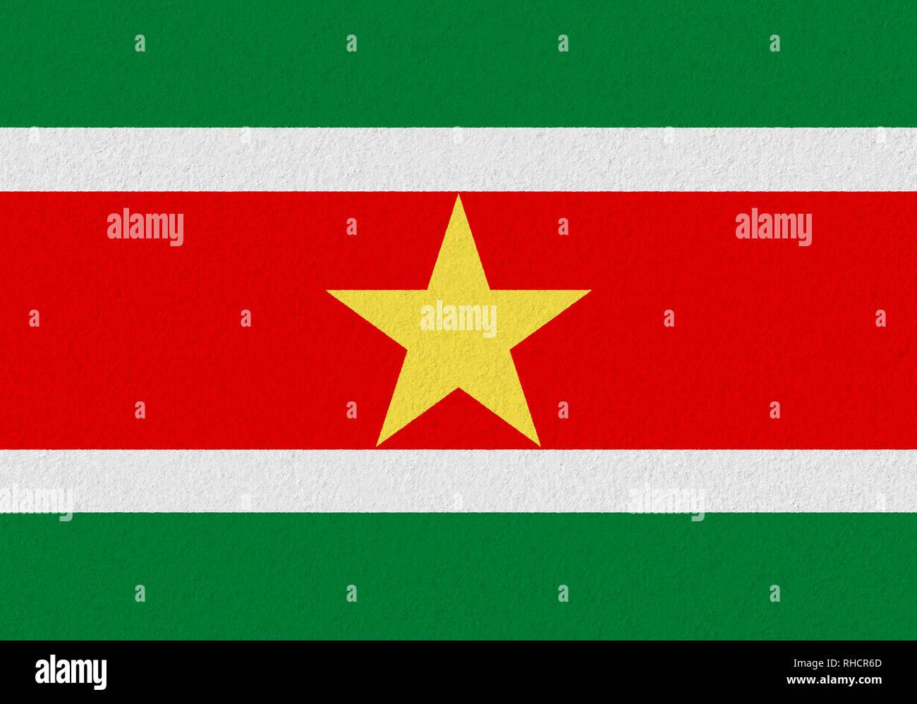 Suriname paper flag. Patriotic background. National flag of Suriname - Stock Image
