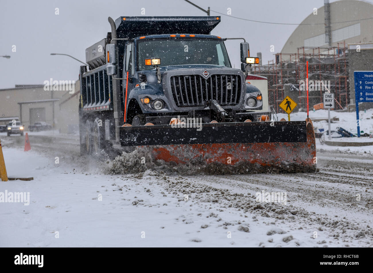 Tech. Sgt. Jason Nelson of the 171st Air Refueling Wing, Civil Engineer Squadron plows the snow to clear the roads during this mornings snowfall near Pittsburgh, Feb. 1, 2019. Nelson spent most of his morning making sure all commercial vehicles had clear, safe roads to travel on. (U.S. Air National Guard photo by Staff Sgt. Bryan Hoover) Stock Photo
