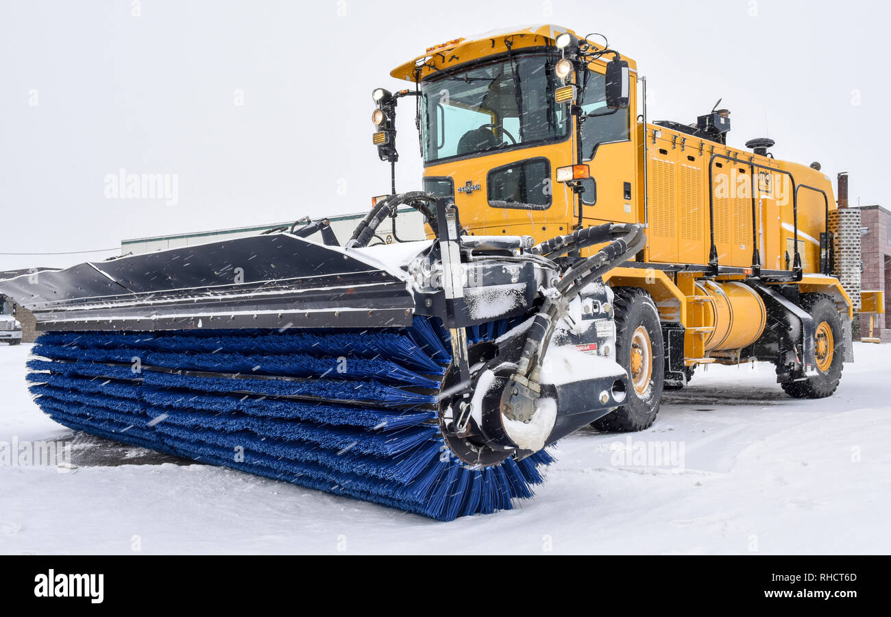 A snow broom at the 171st Air Refueling Wing near Pittsburgh is parked in idol on the aircraft parking ramp in preparation of the morning snowfall Feb. 1, 2019. (U.S. Air National Guard photo by Staff Sgt. Bryan Hoover) Stock Photo