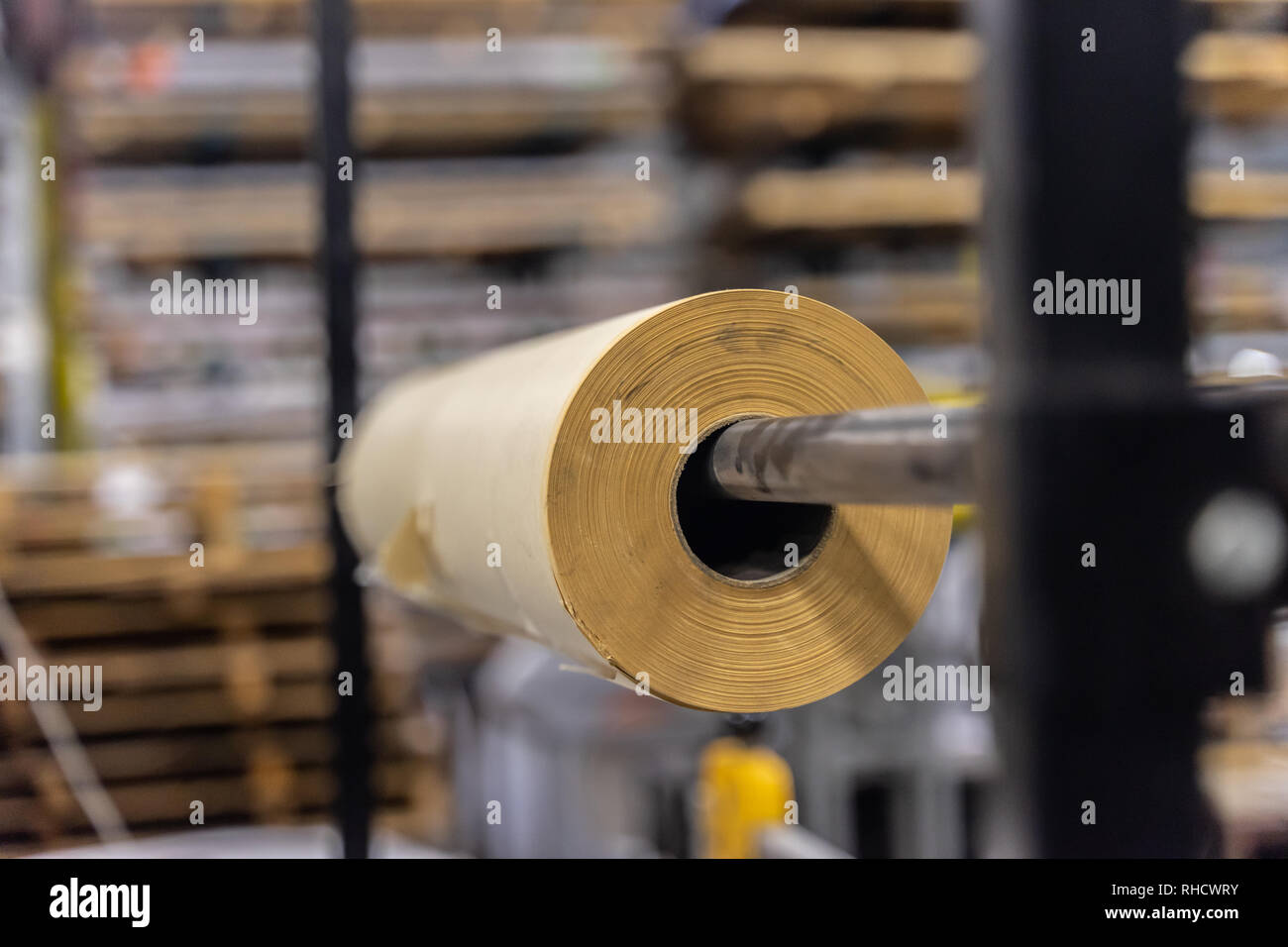 Roll of paper wrapping material in factory workshop packaging - Stock Image