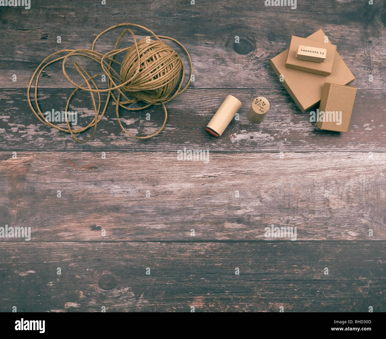 Artistic crafting supplies and art tools of hemp yarn, natural cardboard boxes and stamps for creative homemade gift wrapping and handmade crafts - Stock Image