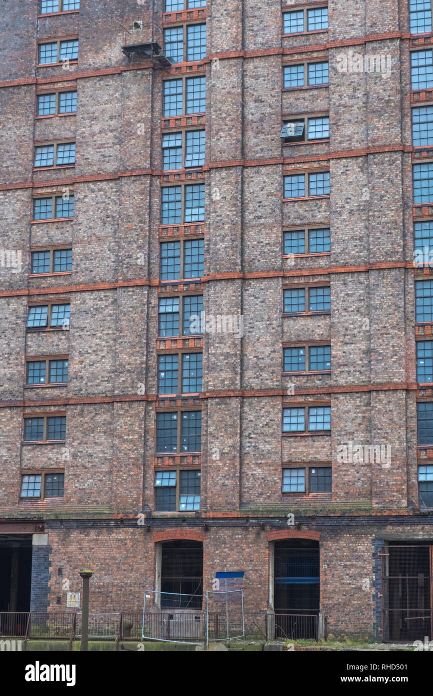 A derelict Victorian tobacco warehouse at the disused Stanley Dock on the Liverpool waterfront UK Stock Photo