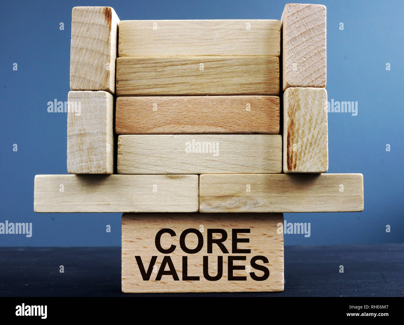 Tower of wooden blocks with sign core values. - Stock Image
