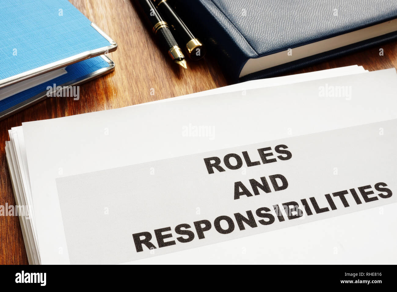 Roles and Responsibilities documents on a desk. - Stock Image