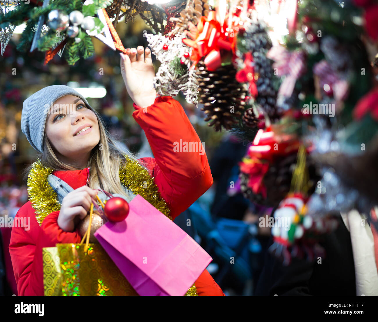 Positive Female With Handmade Christmas Gifts On The Street Market