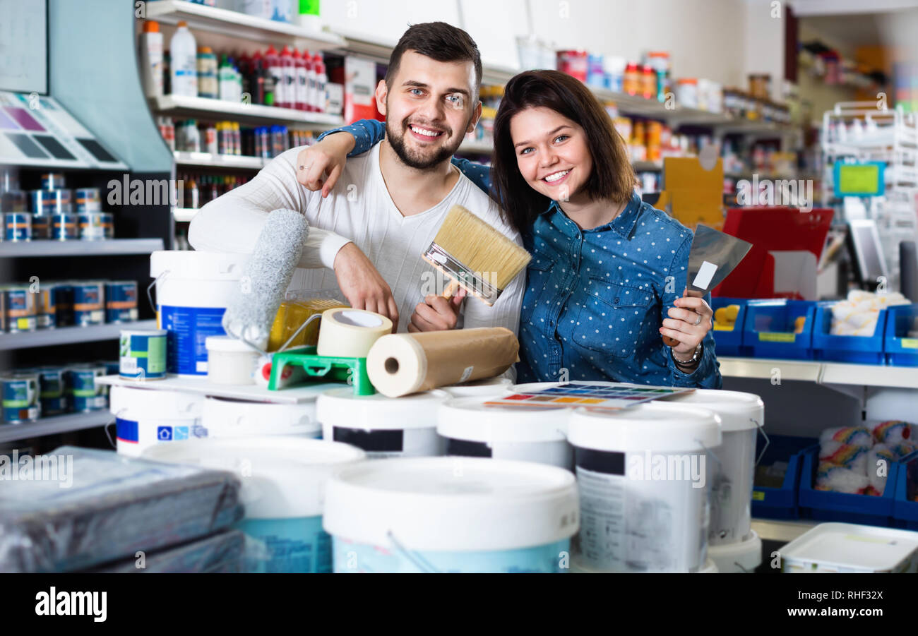 Smiling cheerful positive couple purchasing tools for house