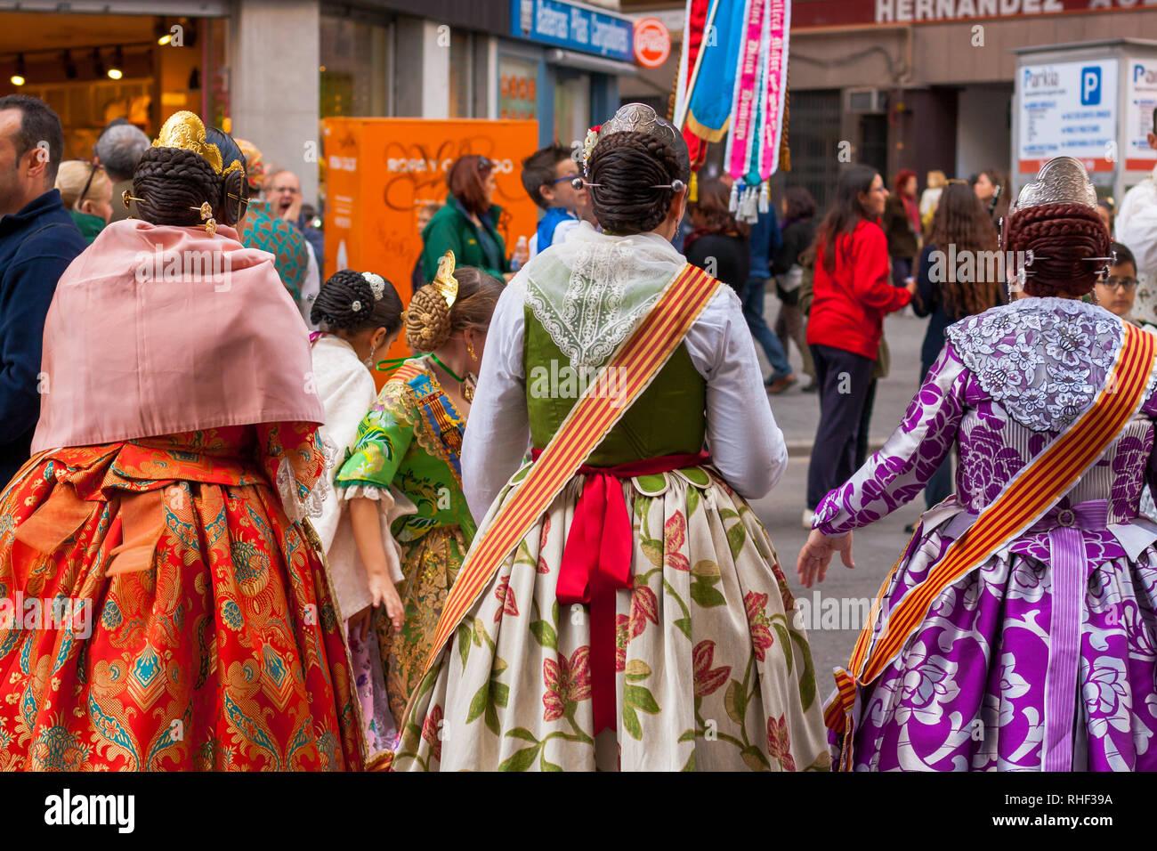 Fallas celebration, woman and girls dresses traditionally, procession. Celebration held in commemoration of Saint Joseph. Falleras. - Stock Image