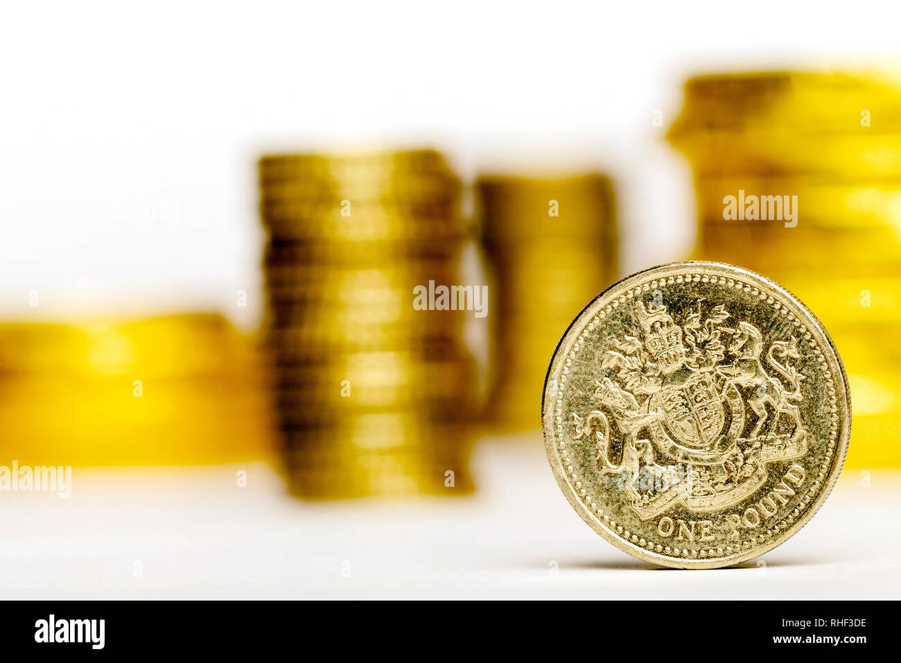 Close up of One British Pound with blurred money on the white background Stock Photo