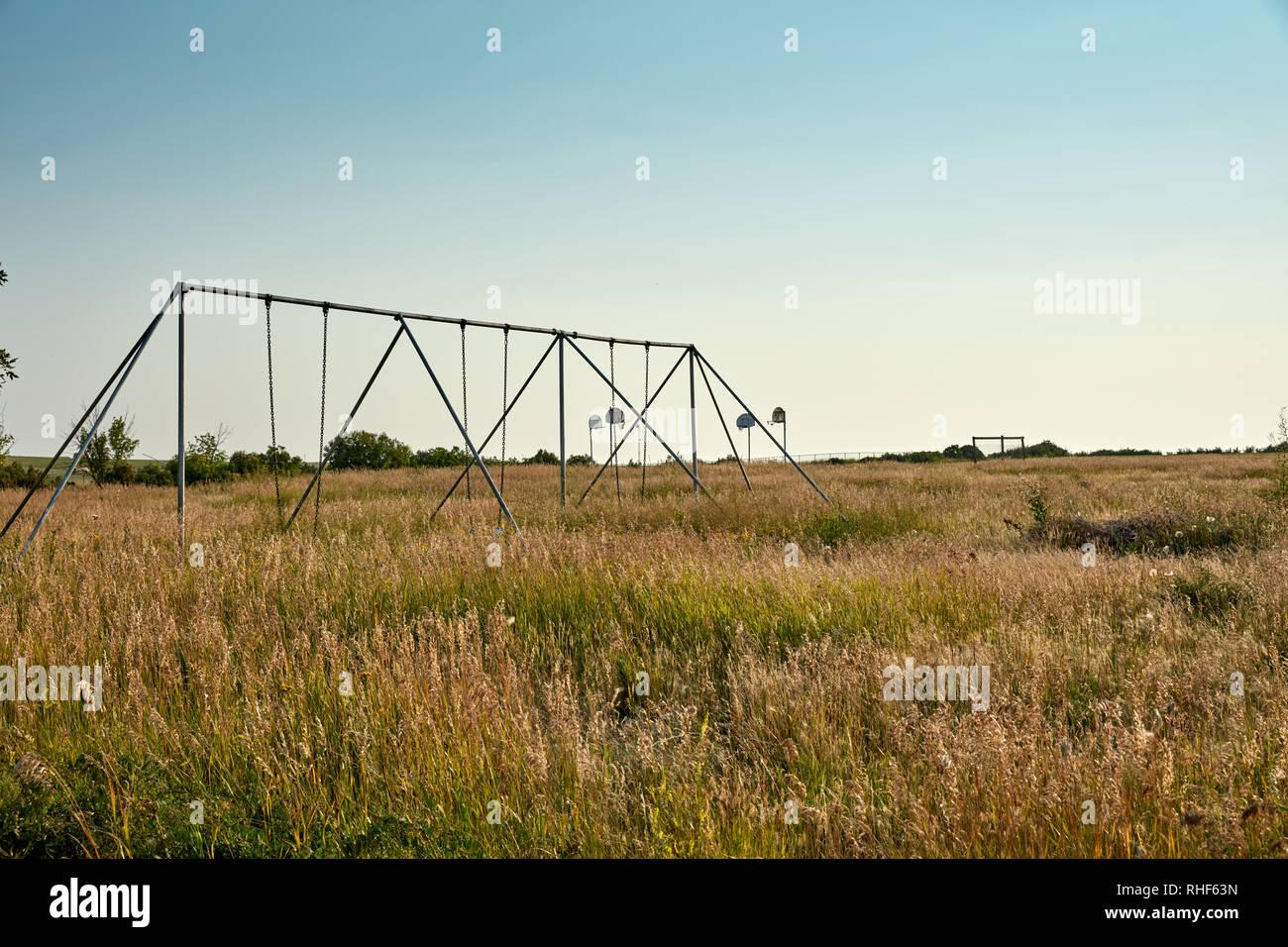 Abandoned swingset and playground in Western North Dakota - Stock Image